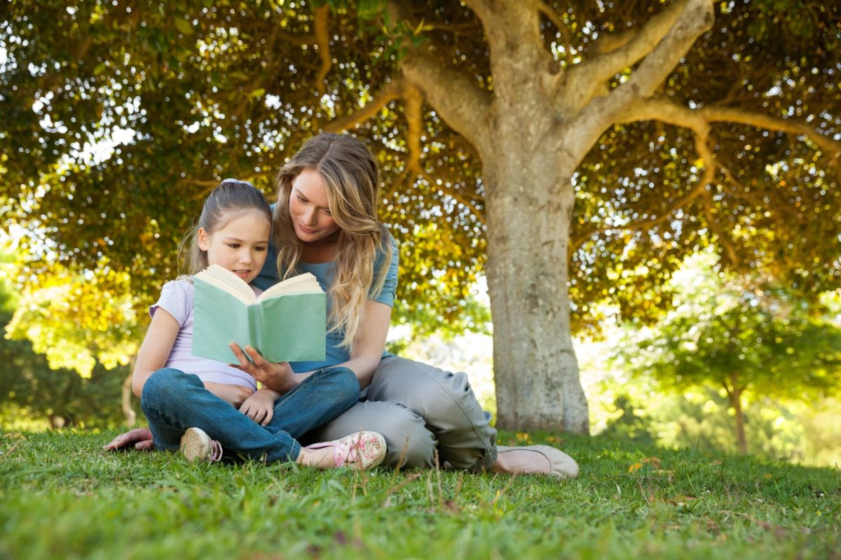 Mother reading a book to her child